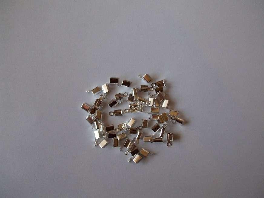 Ukončovací díl na kůži galvanizace 31100 stříbro 1ks.